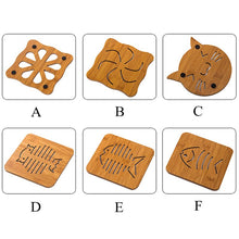 Load image into Gallery viewer, Wooden Super-Cute Drink Coaster/Mat (Cat & Fish Carvings). This picture features all the variants available: type A is the propeller design, type B features a swirl, type C is in the shape of a cat head, type D is a fish skeleton, type e is a more realistic fish version, type F is the most realistic fish skeleton (still in carton shape though).