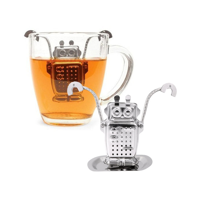 Stainless Steel Robot Tea Infuser Hanging on for Dear Life. This picture features the tea strainer, in the style of a robot. It has arms that can be bent it to fit a cup, leaving its body, made of holes, to act as the tea infuser.