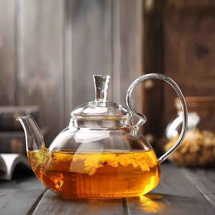 Fancy Glass Moulded Teapot with Infuser Filter. This picture features the teapot in action, brewing some tea.
