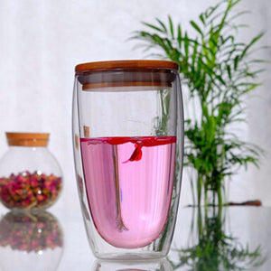 Double Walled Insulated Glass Cups With Bamboo Lid. This picture features all the size variation: 450ml, with some sweet, pink tea in it with a smart bamboo lid on top.