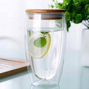 Double Walled Insulated Glass Cups With Bamboo Lid. This picture features the size variation: 450ml, with some water and a slice of lemon in there.