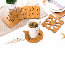 Load image into Gallery viewer, Wooden Super-Cute Drink Coaster/Mat (Cat & Fish Carvings). This pictures features the product in action, protecting the tabletop from the cup's temperature.