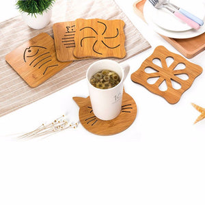 Wooden Super-Cute Drink Coaster/Mat (Cat & Fish Carvings). This pictures features the product in action, protecting the tabletop from the cup's temperature.
