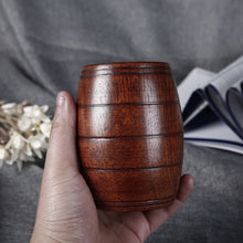 Load image into Gallery viewer, Handmade Wooden Cup in Vintage Beer Mug Style. This picture shows a hand holding the cup, it looks like a nice fit.