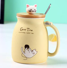 Load image into Gallery viewer, Cute yellow porcelain cat themed keep cup with a bamboo lid featuring a small cat cat as the handle (and it has a spoon). Great for tea, coffee, milk, or other edible drinks of your preference.