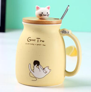 Cute yellow porcelain cat themed keep cup with a bamboo lid featuring a small cat cat as the handle (and it has a spoon). Great for tea, coffee, milk, or other edible drinks of your preference.