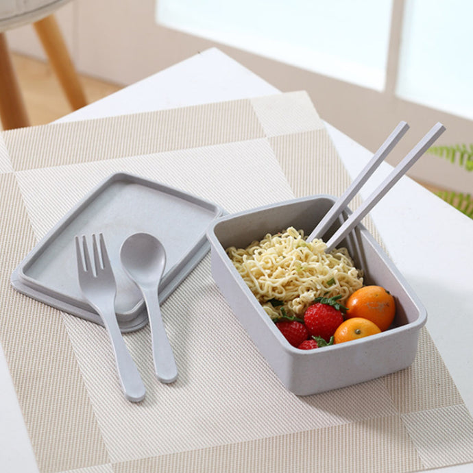 Grey bamboo fibre lunchbox, dishwasher safe. Picture features the lunchbox and matching cutlery and chopsticks, with a serving suggestion.