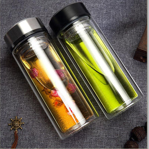 Double Layer Glass Tea Infuser Flask with Stainless Steel Lid. This picture shows both of the variants (silver and black lids) together.