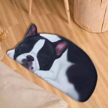 Image of a floor mat in the shape os a cute sleeping Boston Terrier