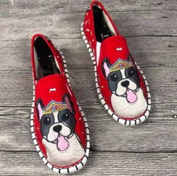 Image of red shoes with a super cute Boston Terrier design