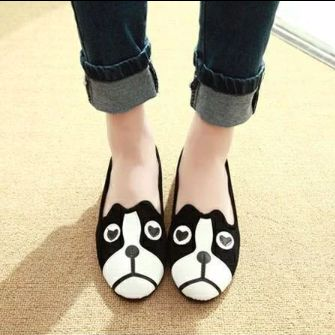 Image of a woman's feet wearing flat slippers with a cute boston terrier design