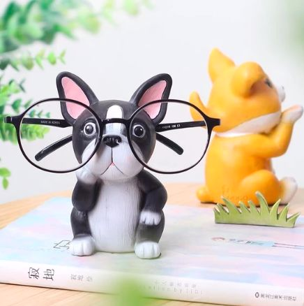 Image of a glasses or shades holder in the shape of a Boston Terrier