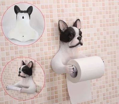Image of a toilet roll holder in the shape of a Boston Terrier with arms stretched out holding the toilet paper