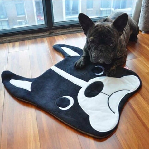 Image of a French Bulldog on top of a Boston Terrier themed rug