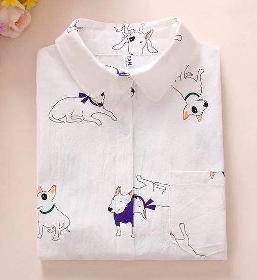 Image of a folded shirt on a table with a cute Bull Terrier design