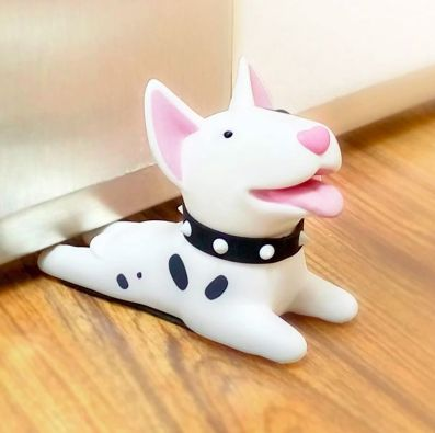 Image of a door stopper on a wooden floor in the shape of a white Bull Terrier dog