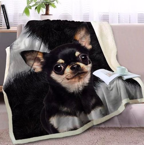 Image of a blanket spread out on a couch with a black Chihuahua design