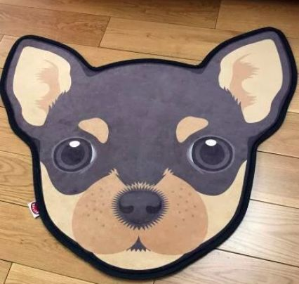 Image of a floor rug on a wooden floor which looks like a Chihuahua's face