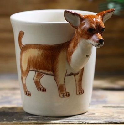 Image of a white cup with a unique 3D chihuahua design