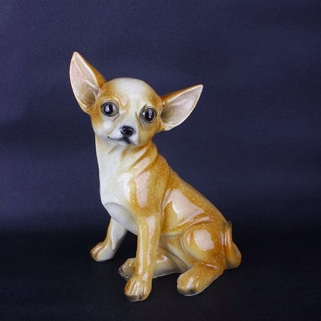 Image of a resin statue for home decor in the shape of a sitting Chihuahua dog