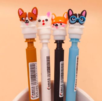 Image of four mechanical pencils top part with cute dog designs, including that of a Corgi