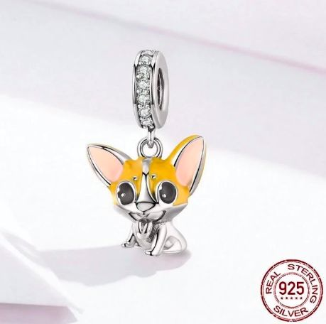 Image of a silver pendant in the shape of a cute Corgi with long pointy ears