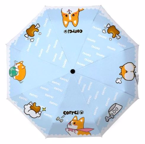Image of an open umbrella from top showing a cute Corgi design on each of the umbrella panels