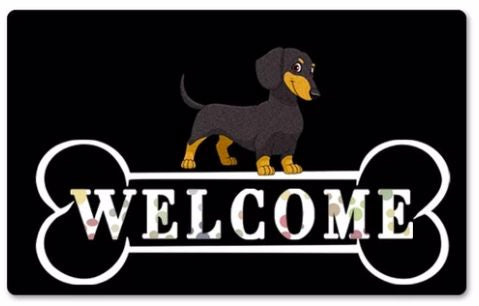 Image of black doormat with a Dachshund standing on top and Welcome written in white