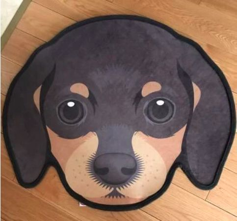 Image of a floor rug in the shape of a cute dachshund face
