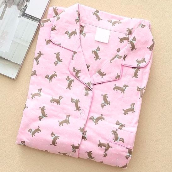 Image of Dachshund Pajamas top lying folded in pink with an infinite dachshund pint