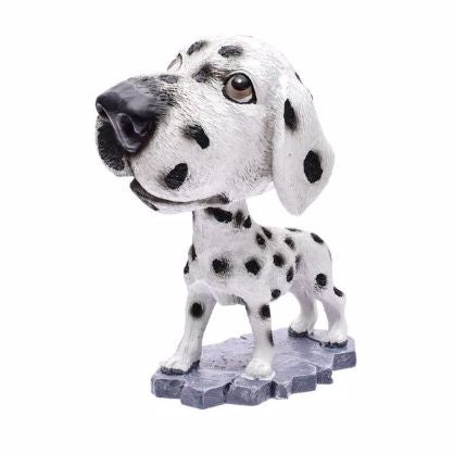 Image of a car bobble head in the shape of a standing Dalmatian dog with a white background