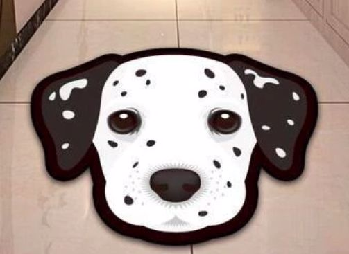 Image of a floor rug in the shape of a Dalmatian dog's face on a white tiled floor