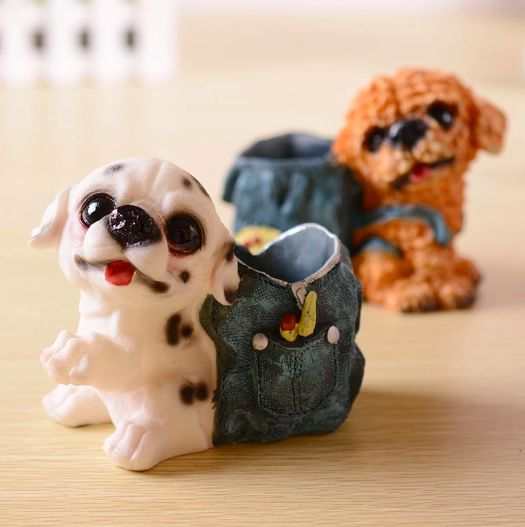 Image of a pen or pencil holder in the shape of a Dalmatian dog wearing a blue backpack