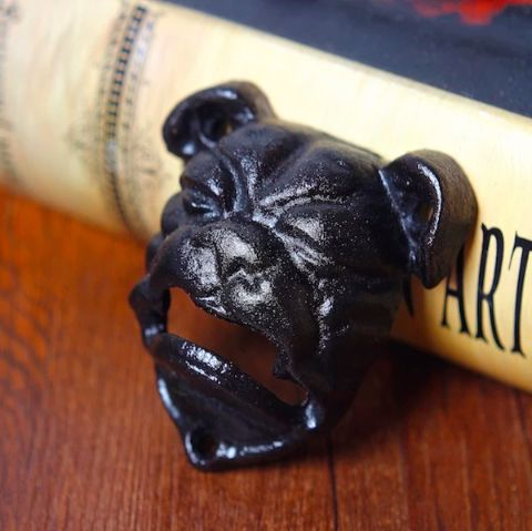 Image of a black cast iron bottle opener in the shape of an english bulldog's face
