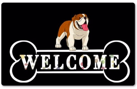 Image of a doormat with an english bulldog printed on top standing on top a welcome sign