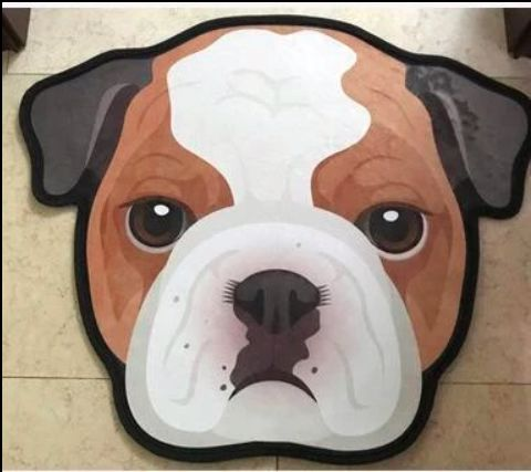 Image of a floor rug in the shape of an english bulldog's face