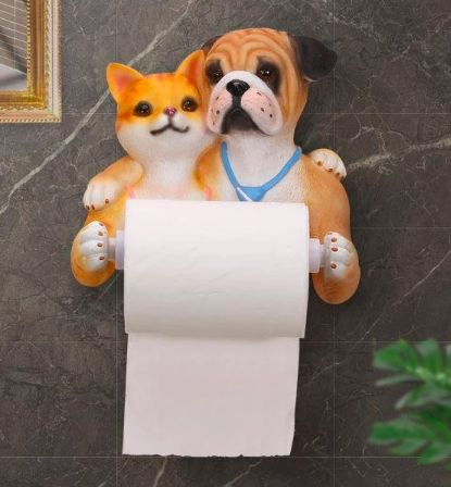 Image of a toilet roll holder shaped like an english bulldog and cat standing side by side with arms over each other