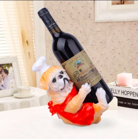 Image of a wine bottle opener in the shape of an English Bulldog wearing a chef's hat with a red apron