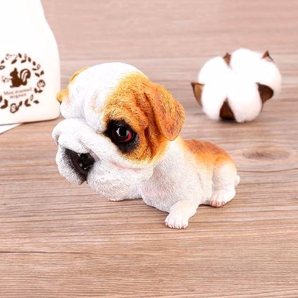 Image of a car bobble head accessory in the shape of an english bulldog