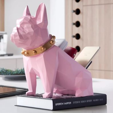 Image of a table top organiser home decor ornament in the shape of a pink french bulldog front view