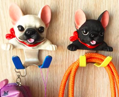 Image of two wall hooks on a wall in the shape of two cute French Bulldogs