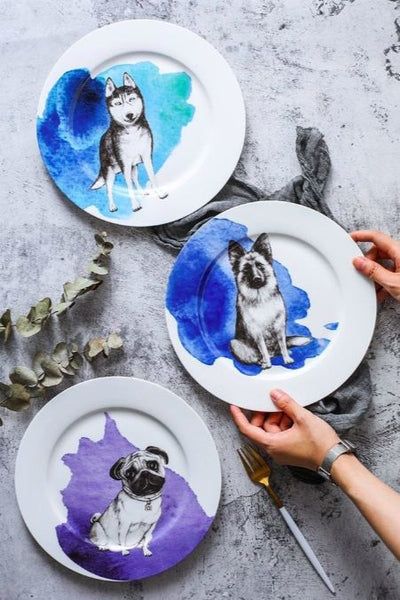 Image of three dinner plates, one with a sitting German Shepherd design