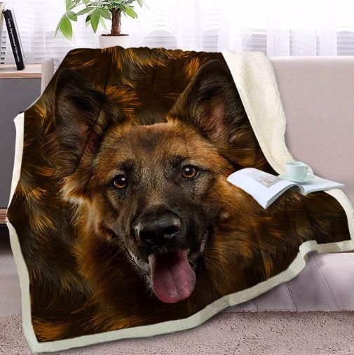 Image of a warm fleece blanket on a sofa with a smiling German Shepherd design