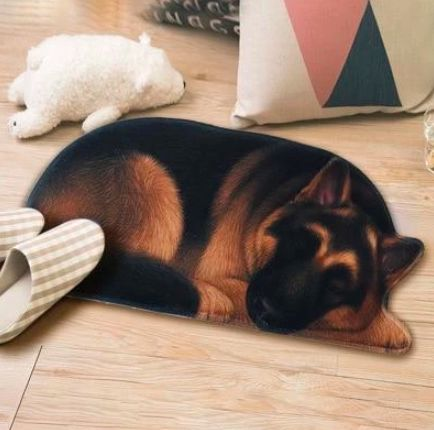 Image of a floor rug which looks like a sleeping German Shepherd dog