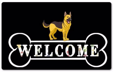 A black rubber doormat with a German Shepherd standing on a large bone which says welcome