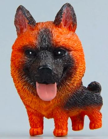 Close up image of a fridge magnet which looks like a standing German Shepherd dog