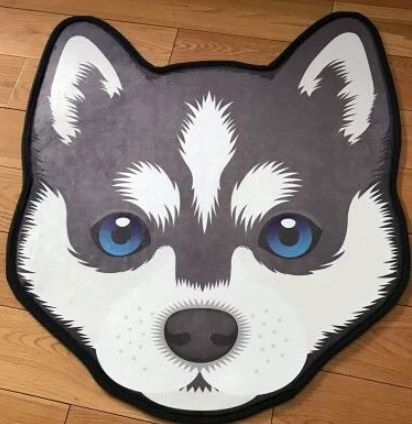 Image of a floor rug on a wooden floor in the shape of a beautiful Siberian Husky face with big blue eyes