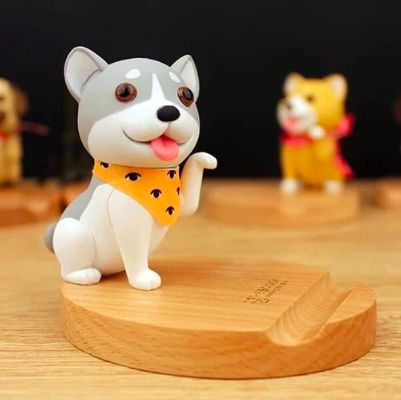 Image of a mobile phone holder on a tabletop in the cute sitting Husky wearing a scarf design