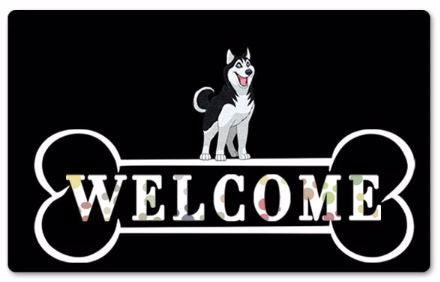 Image of a black rubber doormat with a Siberian Husky standing on top of a huge bone with says Welcome