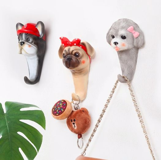 Image of three wall hooks, one in the shape of a girl Poodle dog, and the other two in the shape of a girl Pug and boy French Bulldog
